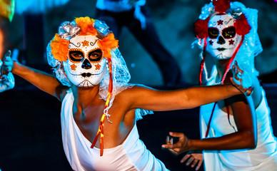 Cabo San Lucas, Mexico - 2018. Closeup portrait of unknown young womans with sugar skull makeup. Dia de los muertos. Day of The Dead.