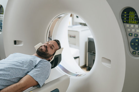 Patient Lying on the CT Scanner Bed