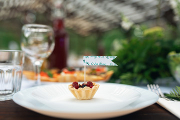 Elegant wedding table arrangement, floral decoration, restaurant. Wedding table setup. Wedding in the forest