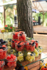 Delicious sweets on candy buffet. Lot of colorful desserts and fruits. Bluberry, watermelon, banana, grape, strawberry