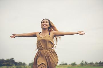 Happy woman running enjoy at grass field