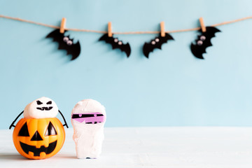 Halloween crafts, orange pumpkin, ghost , mummy and spide, bat on wooden table with copy space for text. halloween concept.