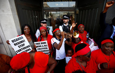 Protesters demonstrate against Ugandan President Yoweri Museveni outside Uganda House in London