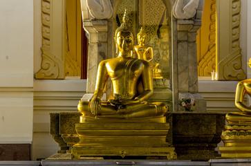 Golden Buddha in sitting position
