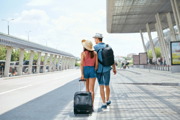Travel. Couple Near Airport With Suitcase Traveling In Summer