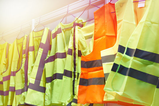Colored, reflective vests for drivers and road workers
