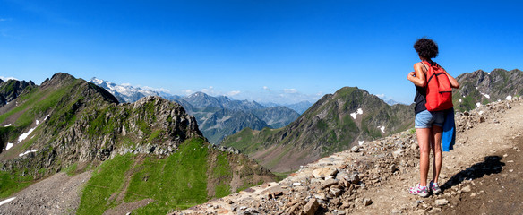 woman hiker on the trail of  Pic du Midi de Bigorre in the Pyrenees