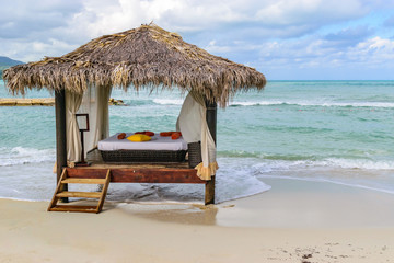 Thatch Roof Massage Hut on tropical beach in Montego Bay,