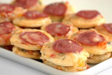Small pizza with mozzarella cheese, sausage