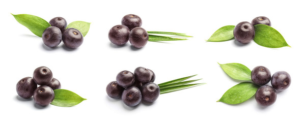 Set with acai berries and green leaves on white background. Organic superfood Fototapete