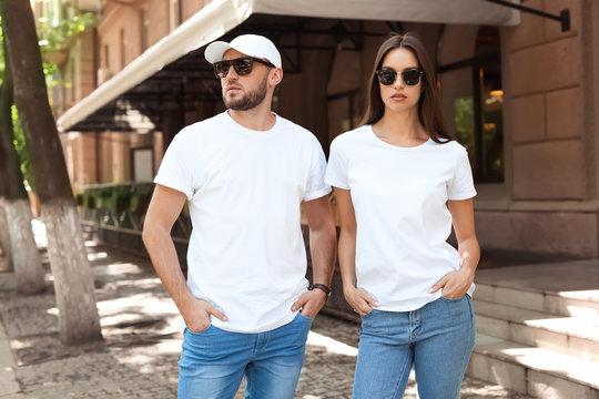 Young couple wearing white t-shirts on street