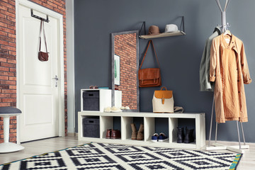Stylish hallway interior with mirror and hanger stand