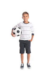 Adorable little boy with soccer ball on white background
