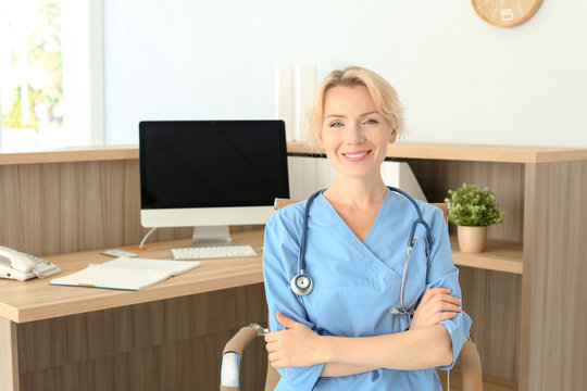 Female medical assistant at workplace in clinic. Health care service