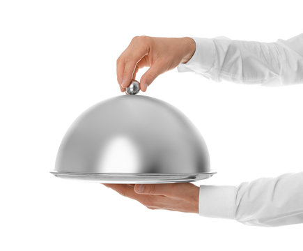 Waiter holding metal tray with lid on white background, closeup