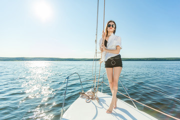 Girl on the bow of the yacht, ship