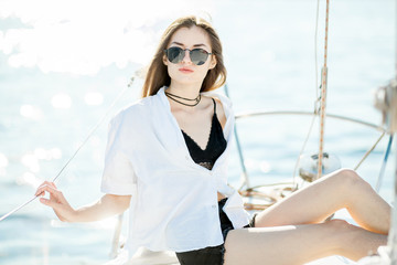 Girl resting on a yacht, sailboat