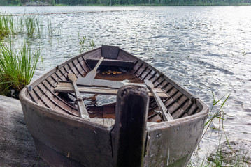 Old wooden rowing boat on the shore of the Saimaa lake in Finland - 16