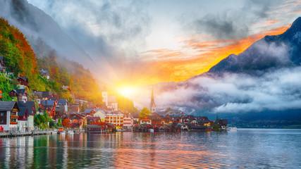 Scenic view of famous Hallstatt mountain village with Hallstatter lake. Foggy autumn sunrise on Hallstatt lake