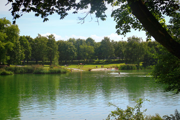 Garching, Bavaria - Summer hot weather in Bavaria,  view of  the Garchinger See, small lake near Munich, ideal for relax, swim and sunbathing