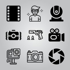 Simple 9 icon set of camera related webcam, video camera, film strip and action camera vector icons. Collection Illustration
