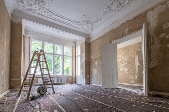 renovation concept - ladder in empty  apartment room during restoration or refurbishment
