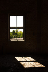 Old brick windows from inside the building and sunlight
