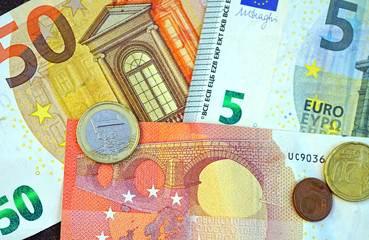 Euro currency in banknotes and coins