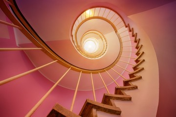 Pink and gradul spiral stairs going up, perspective, high stairs