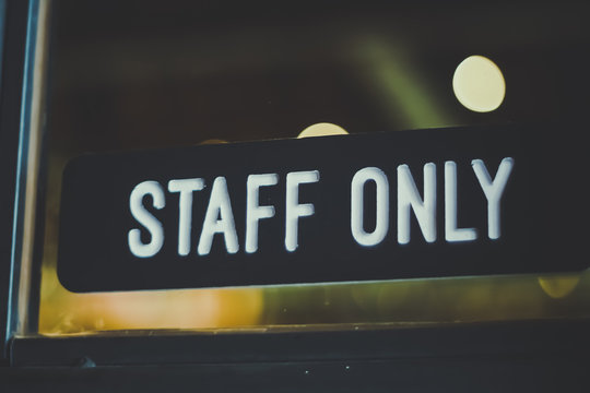 """Sign """"Staff only"""" hang on door in front of coffee shop cafe  background."""