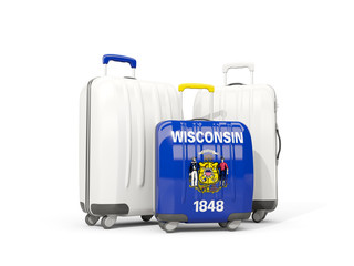 Luggage with flag of wisconsin. Three bags with united states local flags