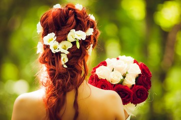 Red hair woman from behind with a bunch of flowers wedding marriage bouquet back bride bridesmaid nature ceremony event romantic valentines day pretty lady