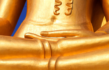Photo fragment of a beautiful statue of a golden Buddha