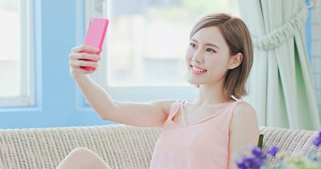 woman use phone selfie