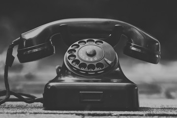 Black and white vintage phone old school close up isolated call ring