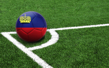 soccer ball on a green field, flag of Liechtenstein