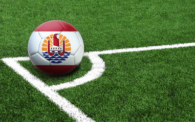 soccer ball on a green field, flag of French Polynesia