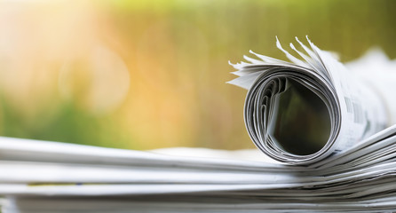 Morning news concept, newspaper stack close-up - web banner idea