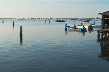 Mussel cultivation, boats at Scardovari lagoon, Po' river delta, Adriatic sea, Italy, UNESCO World Heritage Site.