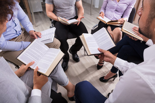 Group Of People Reading Holy Books