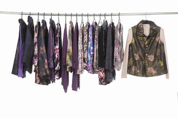 Row of female colorful clothing ,sundress ,jacket, coat on hanger