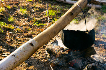 cooking on the fire. camping in the wilderness. healthy food made in traditional way