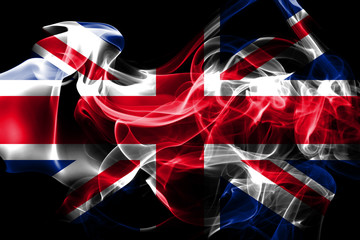 National flag of United Kingdom made from colored smoke isolated on black background