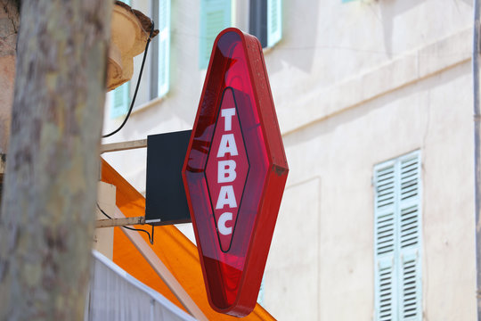 French Red And White Modern Tabac Sign - Close Up View
