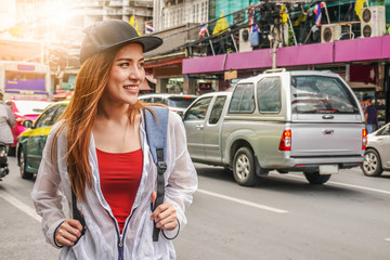 Lifestyle fashion portrait of thai adult young beautiful girl long hair relax and smile,wearing cute trendy outfit