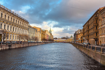 View of Moyka river embankment and Red bridge in Saint Petersburg. Russia