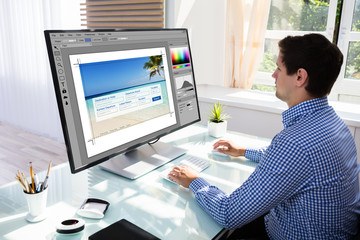 Designer editing photos on computer