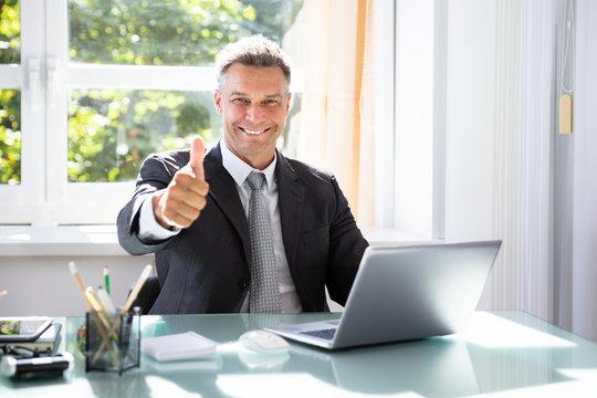 Happy Businessman Gesturing Thumbs Up