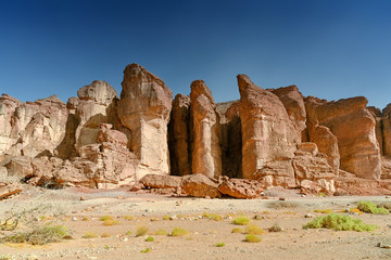 Red Sandstone cliffs in Timna Valley, King Solomon`s Pillars at the first Jewish Temple in Jerusalem, Israel. Panoramic view