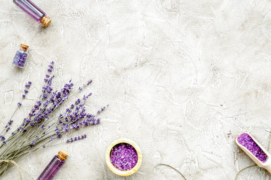 Essential oil and lavender salt with flowers top view